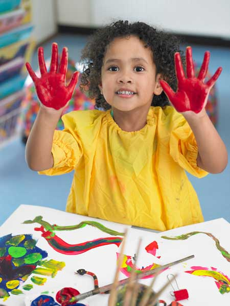 child-painting-red-hands